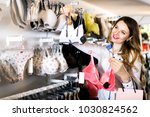 happy woman customer deciding... | Shutterstock . vector #1030824562