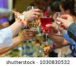 glasses of wine in the hands of ... | Shutterstock . vector #1030830532