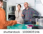 angry couple makes claims at  ... | Shutterstock . vector #1030835146