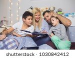 happy mixed race family | Shutterstock . vector #1030842412