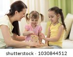 family mom and daughters at the ... | Shutterstock . vector #1030844512