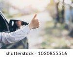 closeup woman driving a car...   Shutterstock . vector #1030855516