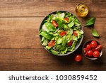green salad with tomato and... | Shutterstock . vector #1030859452