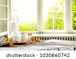 fresh milk and home interior... | Shutterstock . vector #1030860742