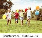 happy children running with...   Shutterstock . vector #1030862812