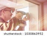 carpenter in glasses working... | Shutterstock . vector #1030863952