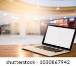 laptop with blank screen on... | Shutterstock . vector #1030867942