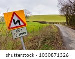a typical narrow rural road in... | Shutterstock . vector #1030871326