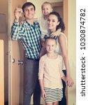 happy parents with daughters... | Shutterstock . vector #1030874782