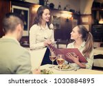 hospitable waitress taking an... | Shutterstock . vector #1030884895