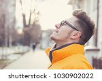 side view of carefree young man ... | Shutterstock . vector #1030902022