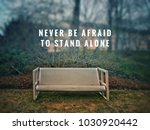 Small photo of Motivational and inspirational quotes - Never be afraid to stand alone. With blurred vintage styled background.
