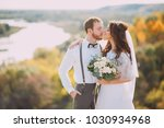 stylish bride and groom posing... | Shutterstock . vector #1030934968