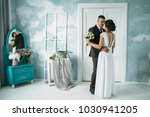 tender wedding couple poses in... | Shutterstock . vector #1030941205