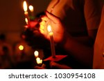 de focused candlelight with... | Shutterstock . vector #1030954108