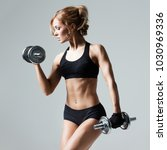 athletic woman pumping up... | Shutterstock . vector #1030969336
