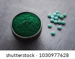 bowls of spirulina algae powder ... | Shutterstock . vector #1030977628