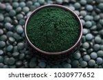 bowls of spirulina algae powder ... | Shutterstock . vector #1030977652