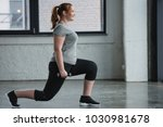 Obese girl performing lunges...