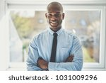 smiling african businessman... | Shutterstock . vector #1031009296