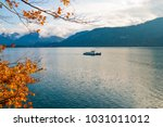 boat makes its way through... | Shutterstock . vector #1031011012