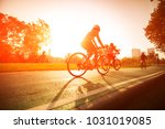 a woman is cycling into the... | Shutterstock . vector #1031019085