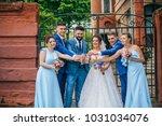 beautiful newlyweds with their... | Shutterstock . vector #1031034076