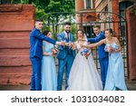 beautiful newlyweds with their... | Shutterstock . vector #1031034082