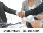 confident handshake of business ... | Shutterstock . vector #1031065885