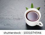 strong black tea in white cup... | Shutterstock . vector #1031074546