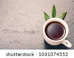 strong black tea in white cup... | Shutterstock . vector #1031074552