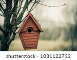 lonely bird house | Shutterstock . vector #1031122732