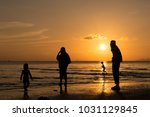 A Family At The Beach With...