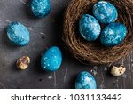 easter eggs in nest painted by... | Shutterstock . vector #1031133442