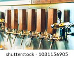 the beer taps in a pub. nobody. ... | Shutterstock . vector #1031156905