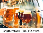 the beer taps in a pub. nobody. ... | Shutterstock . vector #1031156926