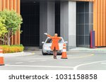 traffic controller helping the... | Shutterstock . vector #1031158858
