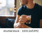 a glass with a cold refreshing... | Shutterstock . vector #1031165392