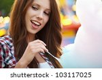 woman with candy floss in the... | Shutterstock . vector #103117025