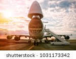 unloading wide body transport... | Shutterstock . vector #1031173342