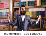 Small photo of Going crazy, mad and insane, wild, stress and agression, shame, hysteria, accuse, blame, fault, rage, responsibility, uncontrollable agressive angry evil rude man in library