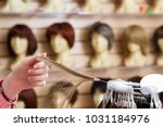 girl in her hand chooses a hair ... | Shutterstock . vector #1031184976