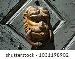 old knocker on the wooden... | Shutterstock . vector #1031198902