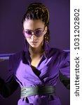 stylish  girl posing in ultra... | Shutterstock . vector #1031202802