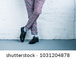 cropped shot of man in stylish... | Shutterstock . vector #1031204878