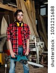 joiner in the workshop saws the ... | Shutterstock . vector #1031211688