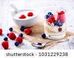 yoghurt with forest fruits in... | Shutterstock . vector #1031229238