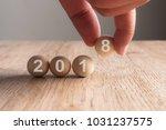 hand putting on 2018 word... | Shutterstock . vector #1031237575