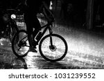 bicycle in the traffic during a ... | Shutterstock . vector #1031239552