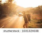 young backpacking adventurous... | Shutterstock . vector #1031324038